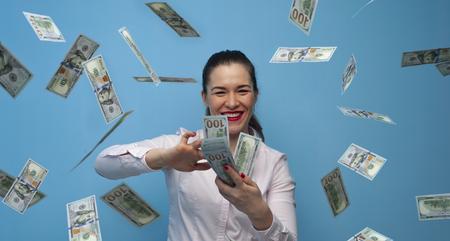 Portrait of young joyful business woman enjoying money cash fan Banco de Imagens