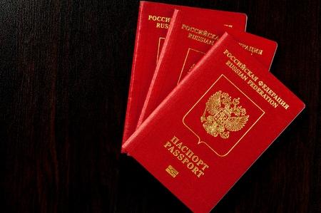 Russian passports on black wooden table Stock Photo