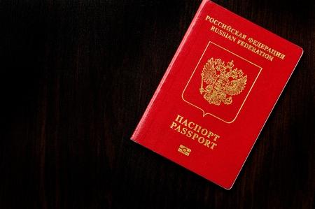 Russian passport on black wooden table
