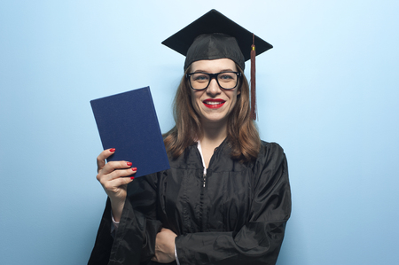 Graduate female student with stubble in eyeglasses wearing black mantle