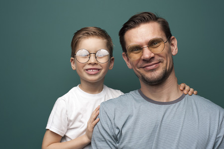 Shot of handsome caucasian father and son wearing stylish eyeglasses