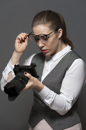 Portrait of female photographer with a camera