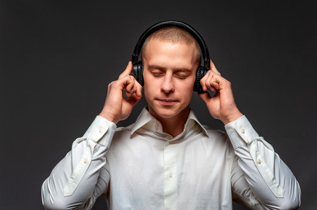 Young male music lover listens to music