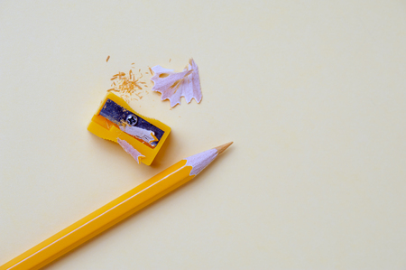 Yellow pencil and metal sharpener on workplace