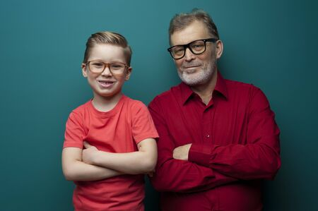 Portrait of a positive grandfather and grandson