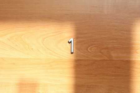 Table number one hanging on a wooden door