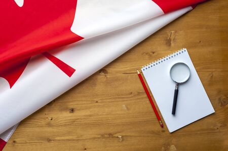 Top view flag of Canada notepad and magnifier