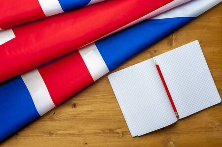 Top view of flag of Great Britain lies on table