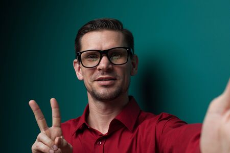 Portrait of a positive young man in glasses Stock Photo