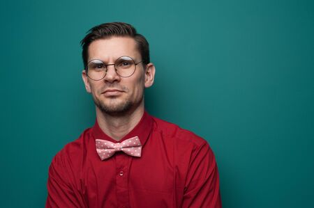 Portrait of a serious young man in a red shirt Stock Photo