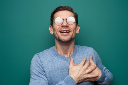 Portrait of a young positive man Stock Photo