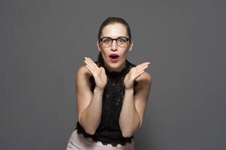 Beautiful young shocked emotional caucasian woman Stock Photo