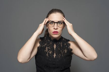 Shocked young caucasian woman in glasses Stock Photo