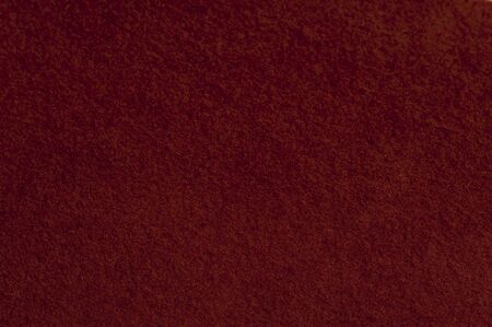 Close-up burgundy woolen cloth from a hat