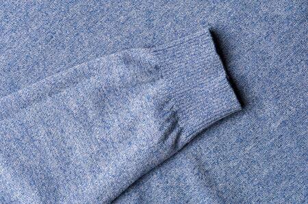 Fragment of warm knitted blue sweatshirt