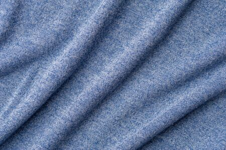 Close-up blue knitted fabric from sweaters