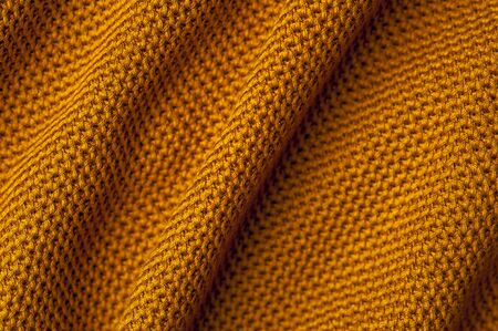 Close-up crumpled orange knitted fabric