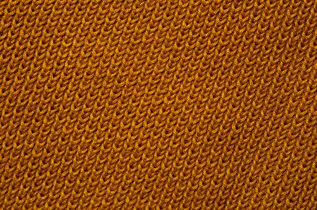 Close-up of an orange knitted fabric