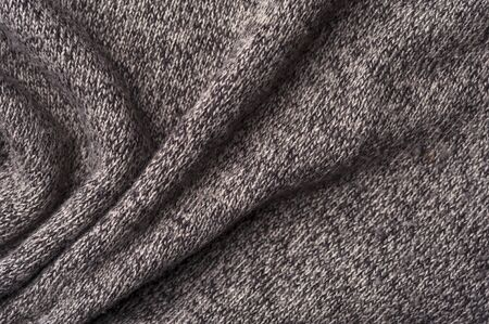 Close-up of a crumpled gray knitwear