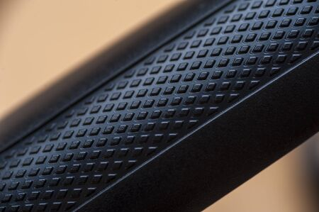 Close-up the metal casing of a black iron tube from a device or gadget. The concept of modern devices and electrical appliances Stock Photo