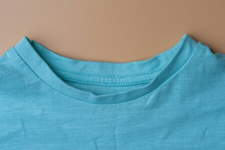 Fragment of neck of beautiful mint cotton t-shirt