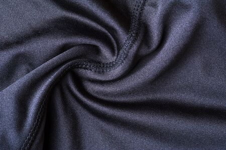 Close-up fragment of crumpled gray polyester wear. Concept of quality sportswear. Advertising space. Place for text