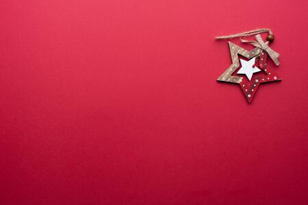 Wooden Christmas Toy on Red Background 写真素材
