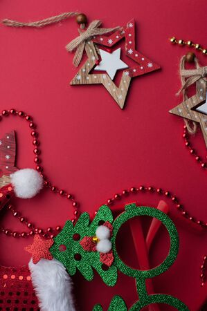 Christmas Headband, Funny Glasses With Green Trees and Wooden Toys on Red Background. 写真素材