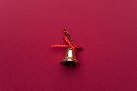 Christmas Handbell on Red Background