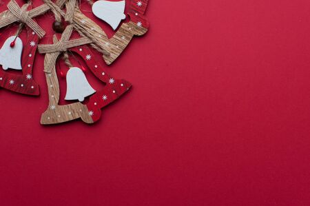 Wooden Christmas Handbells on Red Background 写真素材 - 134356663