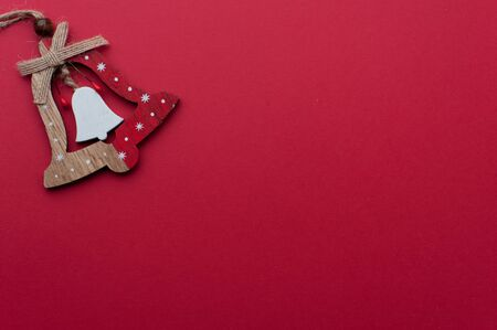 Wooden Christmas Handbell on Red Background 写真素材 - 134356679