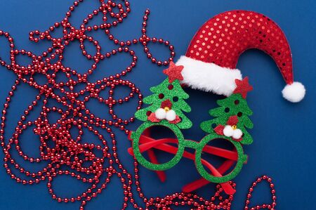 Christmas Headband, Funny Glasses With Green Trees and Beads on Blue Background.