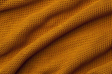 Close-up crumpled orange knitted fabric 写真素材 - 134427319