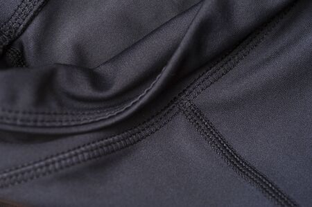 Close-up fragment of black nylon garment 写真素材 - 134427324