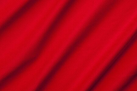 Fragment of crumpled red polyester fabric