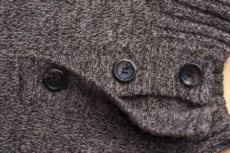 Close-up of a gray knitted warm jacket 写真素材 - 134427346