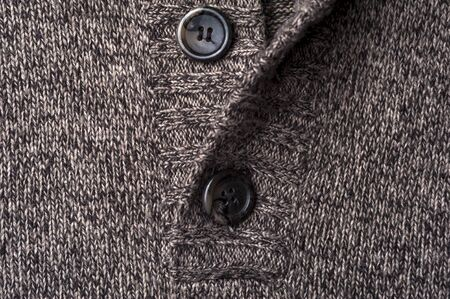 Close-up fragment of a gray knitted warm jacket