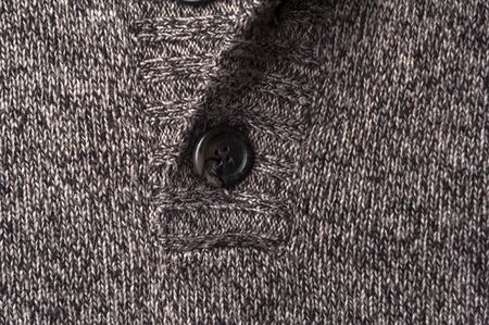Close-up fragment of a gray knitted warm jacket 写真素材 - 134427352