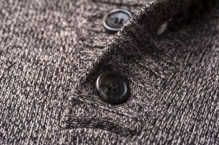 Close-up of a gray knitted warm jacket
