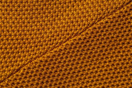 Close-up of an orange knitted fabric 写真素材 - 134427360