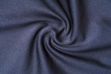 Fragment of crumpled gray polyester wear