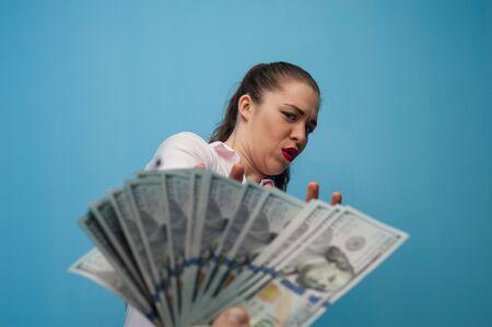 Woman backs away refusing a bribe 写真素材