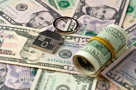 Close-up dollar bills and money roll