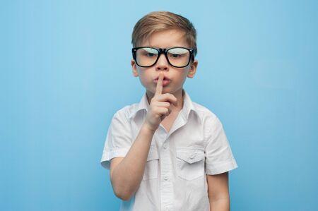 Portrait of a cute little boy showing a silence