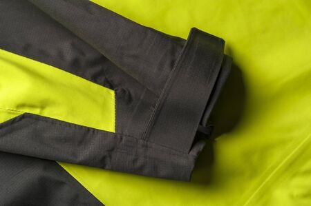 Close-up fragment of a green-gray jacket