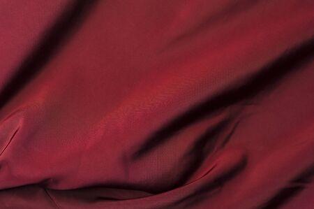 Fragment of a burgundy jacket windbreaker