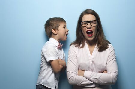 Portrait of emotional mom and baby screaming Stock Photo - 135777394