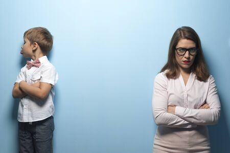 Angry young pretty mother and little naughty boy Stock Photo - 135777396