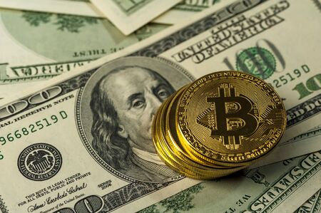 Close-up of a stack of Bitcoin gold coins Stock Photo - 135777398