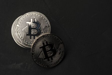 Close-up of a stack of silver Bitcoin coins Stock Photo - 135777402